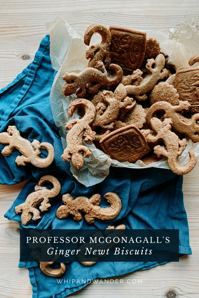 a teal towel covered in Professor McGonagall's Ginger Newt Biscuits and a tin of additional ginger biscuits resting nearby