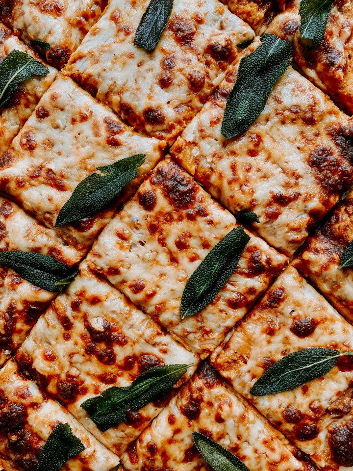 a Pumpkin Pizza with Gruyere and Crispy Sage that's been sliced into squares