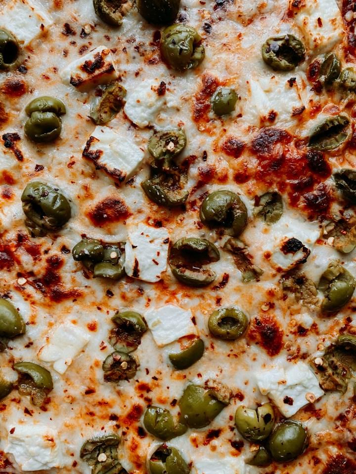 closeup of Green Olive and Feta Pizza
