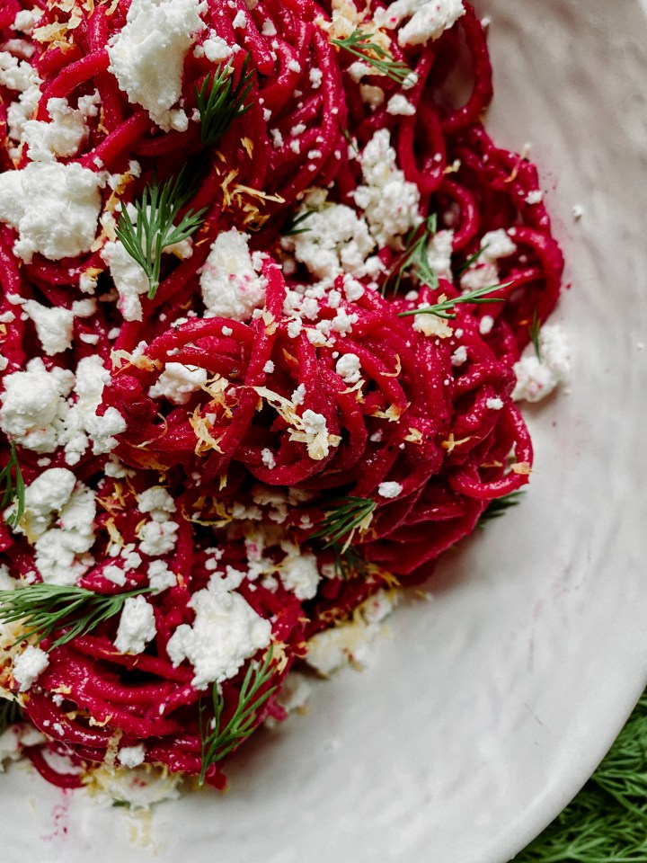 Pasta with Ricotta Beet Sauce with goat cheese and dill in a white dish