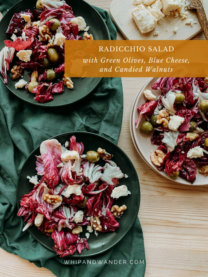 a dark greek towel witht wo dark green plates on top covered in Radicchio Salad with Green Olives, Blue Cheese, and Candied Walnuts and a pink plate to the right covered in the same salad