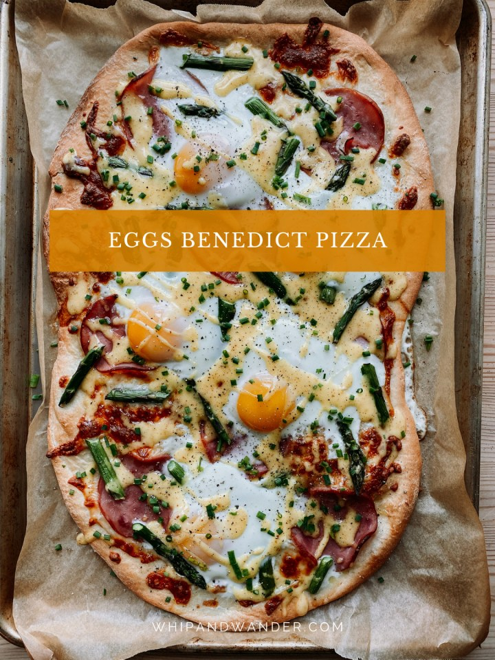 a whole Eggs Benedict Pizza on a parchment lined baking sheet