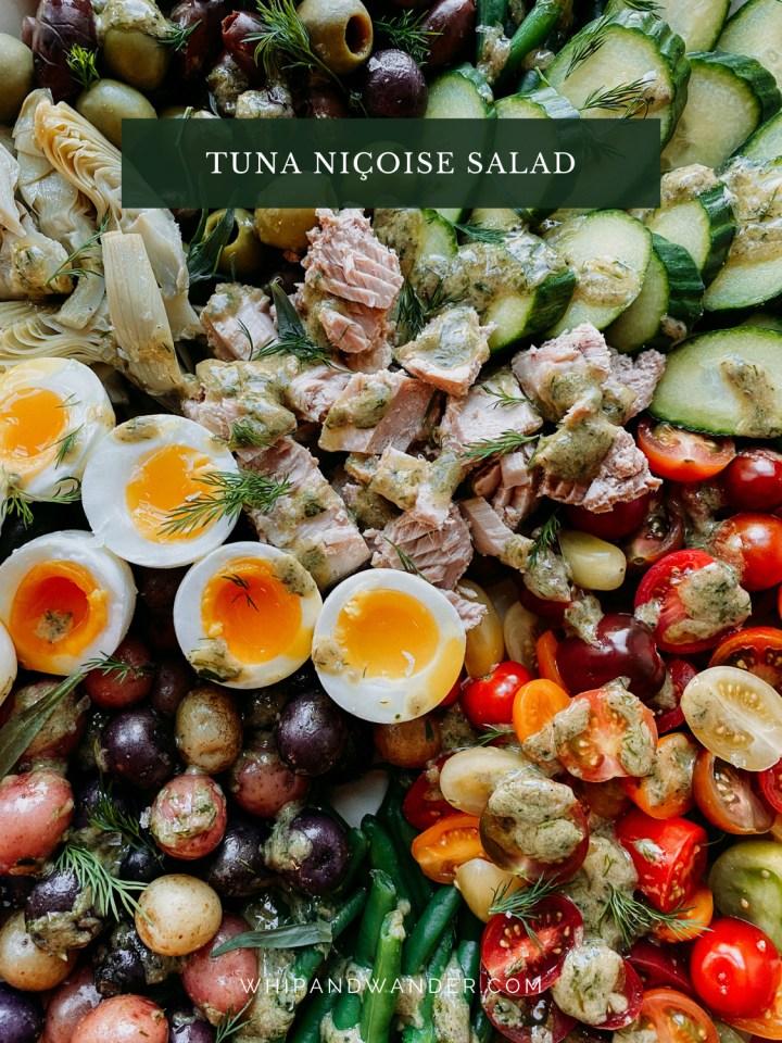 closeup of jammy eggs on a Tuna Salad Nicoise
