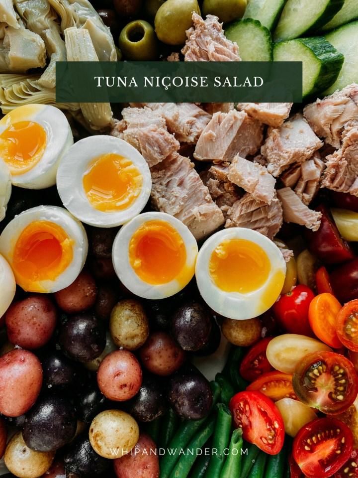closeup of 6 minute eggs on a Tuna Salad Nicoise with potatoes