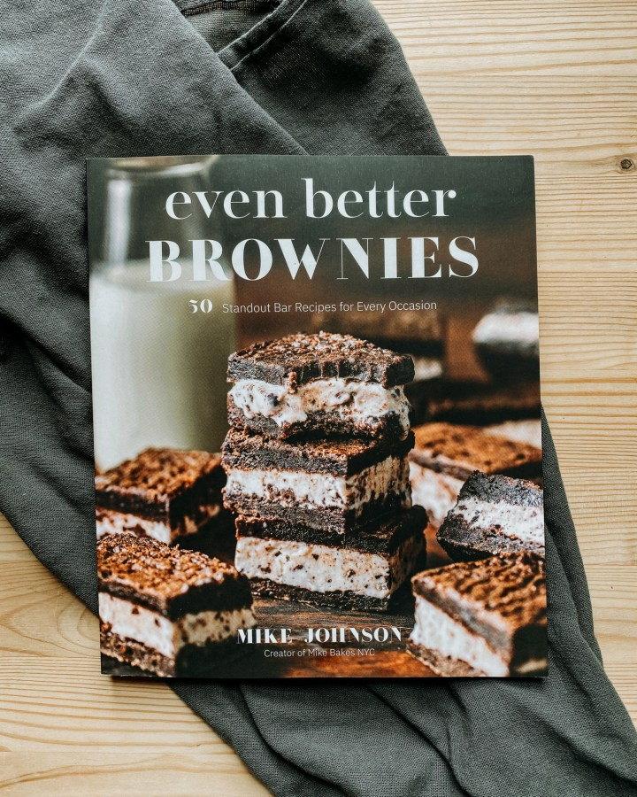 The book Even Better Brownies resting on a gray towel on a wooden surface