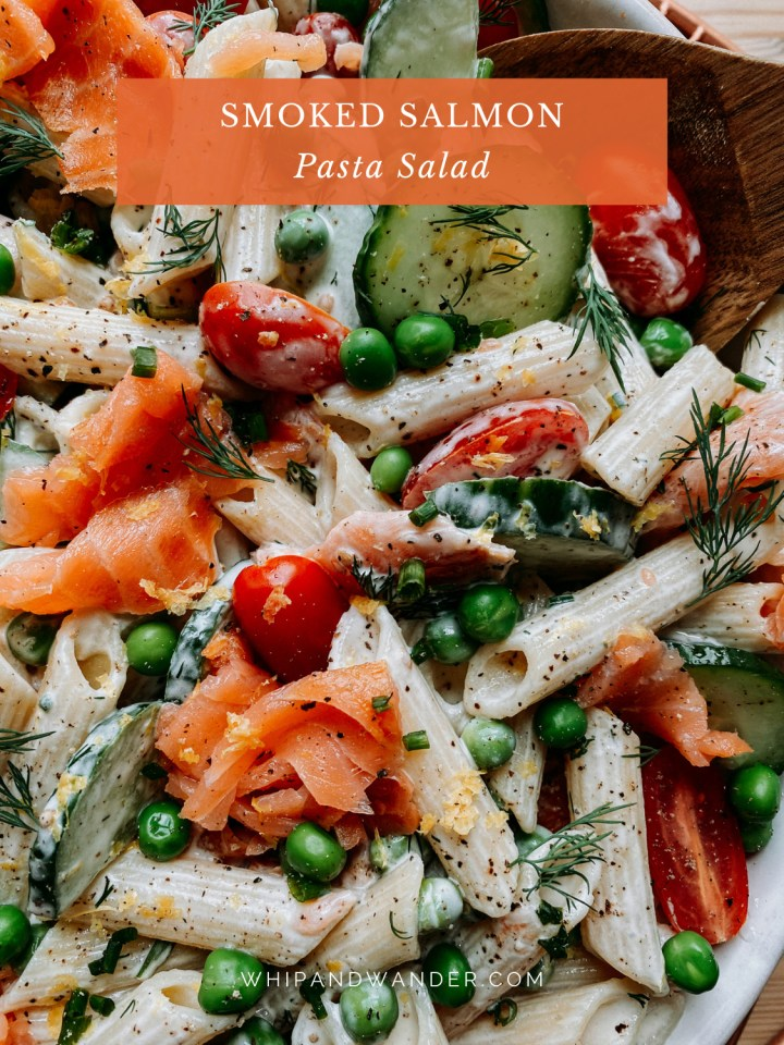 peas, cucumbers, tomatoes, and smoked salmon in a penne pasta salad