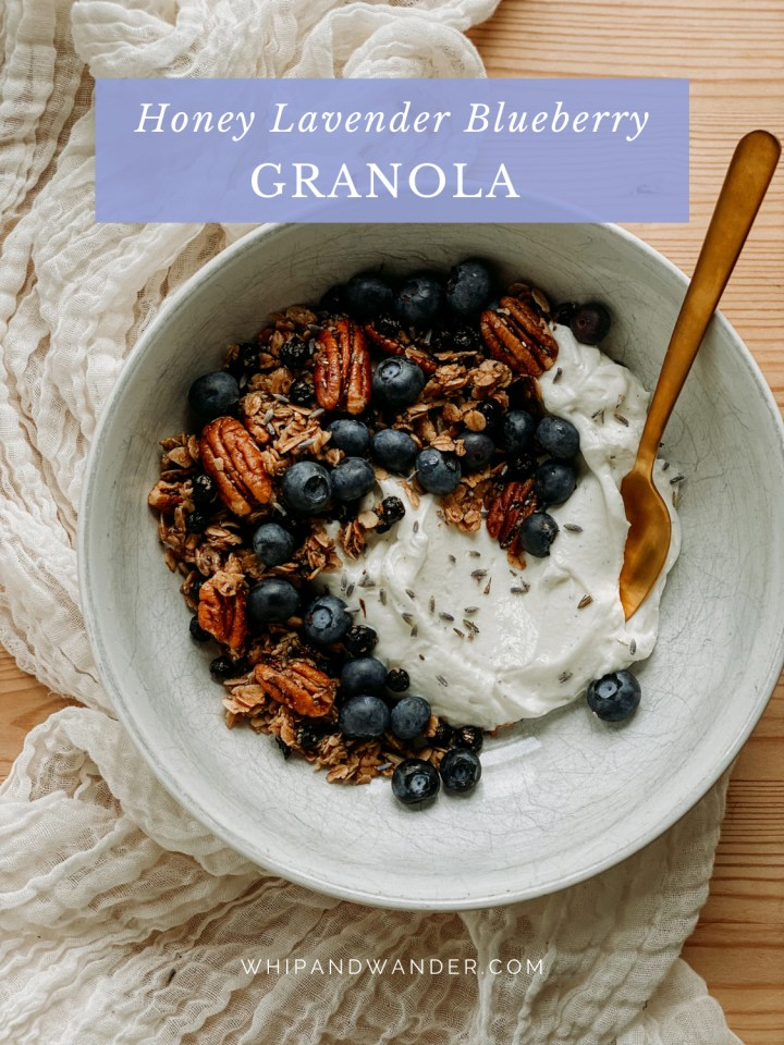 a white bowl with a Honey Lavender Blueberry Granola and yogurt parfait and a gold spoon