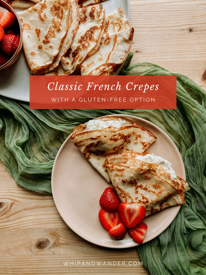 a green cloth with a pale pink plate and a white plate both containing crepes and strawberries