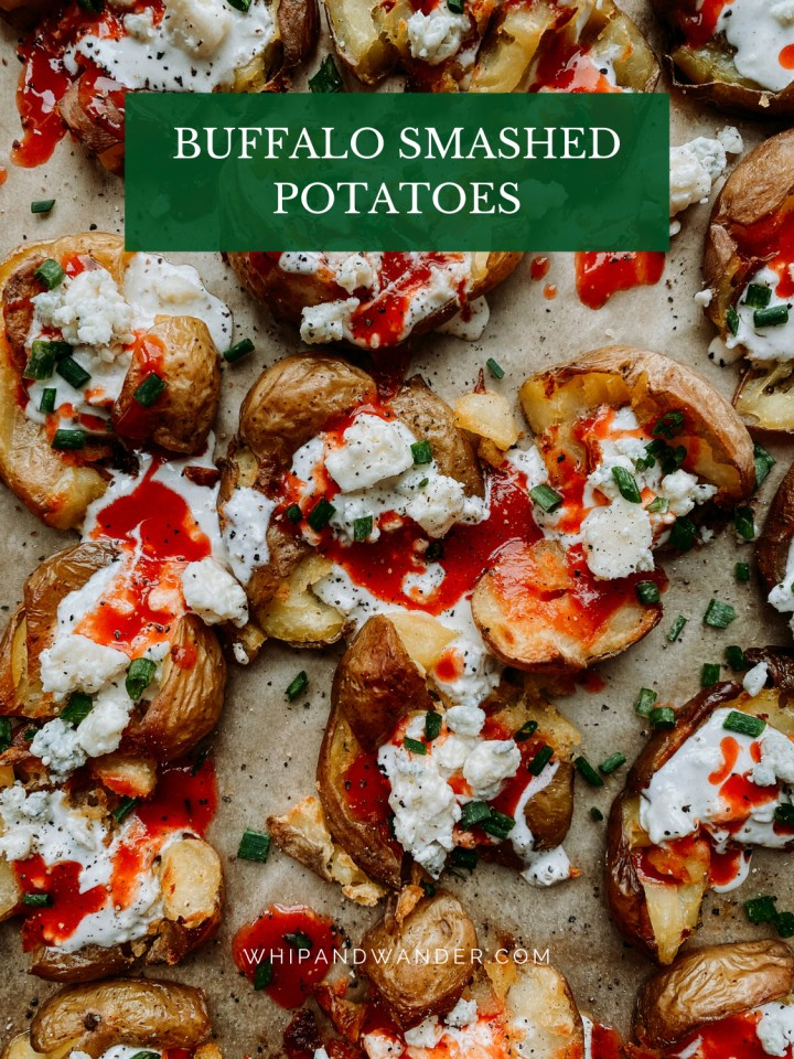 red buffalo sauce, blue cheese crumbles and dressing, and herbs on top of roasted smashed potatoes