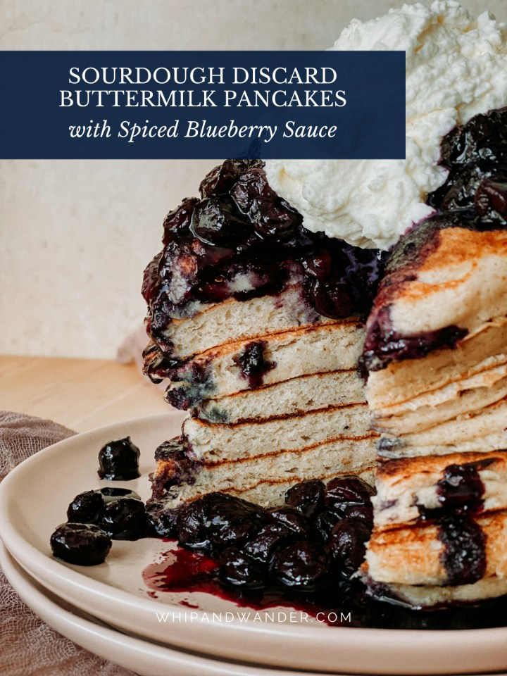 the cross section of the inside of a stack of pancakes with blueberry sauce and whipped cream