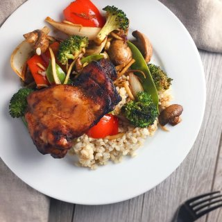 Sheet pan sweet spiced chicken thighs and vegetables on a plate