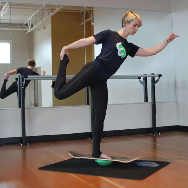 Fitness yoga one leg balance on whirly board