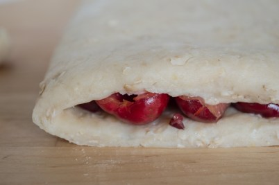 fresh cherries in folded dough