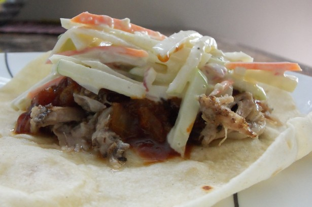 slaw over pulled pork and whiskey bbq taco