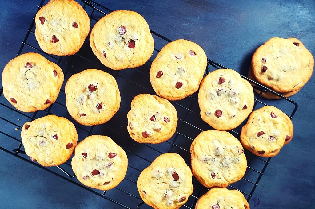 Homemade chocolate chip cookies sitting on a cooling rack. You will love these easy chocolate chip cookies with no brown sugar. It is so tasty, it may even become your favorite chocolate chip cookie recipe!