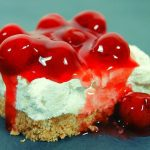Easy no bake cherry delight bars with graham cracker crust, cream cheese mixture with dream whip and cherry topping