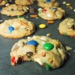Thick trash cookies, also known as kitchen sink cookies, loaded with potato chips, pretzels, m&ms, chocolate chips, peanut butter cups and sprinkles.