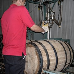 "A Maker's Mark Distillery worker fills a new barrel with ""white dog"" spirit. Photo ©2008 by Mark Gillespie."