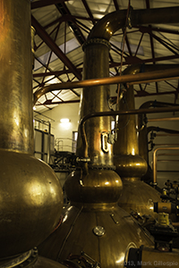 The stillhouse at Mortlach Distillery in Dufftown, Scotland. Photo ©2013 by Mark Gillespie.