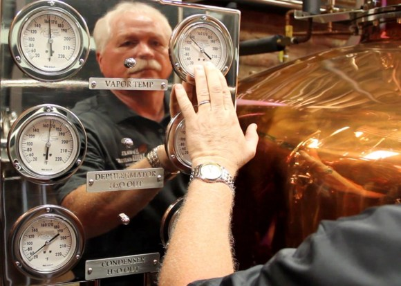 Charlie Downs of the Evan Williams Bourbon Experience reflected in his stillroom's instrument panel September 16, 2014. Photo ©2014 by Mark Gillespie.