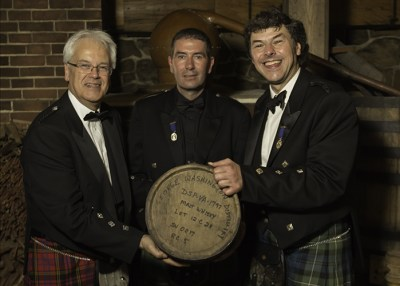 Distillers Andy Cant, John Campbell, and Bill Lumsden with one of the casks used to mature George Washington's Single Malt October 13, 2015. Photo ©2015 by Mark Gillespie.