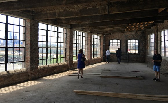 Philadelphia Distilling's Andrew Auwerda shows off what will become the distillery's new event space during a tour. Photo ©2016, Mark Gillespie/CaskStrength Media.