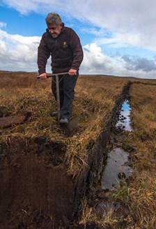 Lagavulin's Iain McArthur cutting peat at his family's bog October 18, 2016. Photo ©2016, Mark Gillespie/CaskStrength Media.