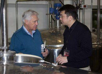 Dr. Jim Swan and King Car Distillery's Ian Chang examine a fermenter at the distillery. File photo ©2011, Mark Gillespie/CaskStrength Media.