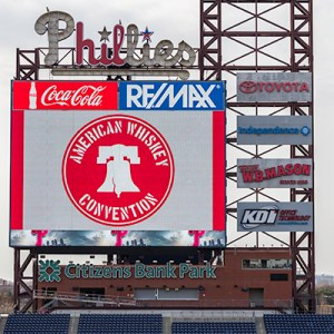 The American Whiskey Convention's logo displayed on the giant screen at Philadelphia's Citizens Bank Park March 24, 2017. Photo ©2017, Mark Gillespie/CaskStrength Media.