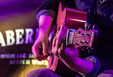A guitarist performs during a Spirit of Speyside Festival concert in Aberlour, Scotland in 2015. Photo ©2015, Mark Gillespie/CaskStrength Media.