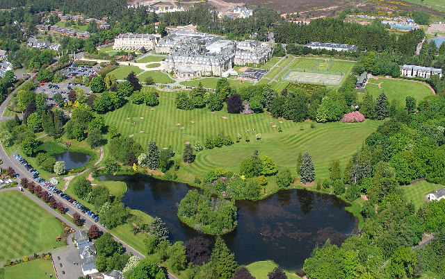 """Gleneagles Hotel and grounds"" by Simon Ledingham. Licensed under CC BY-SA 2.0 via Wikimedia Commons."