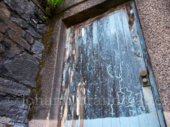 Door to one of the abandoned buildings at the Convalmore Distillery