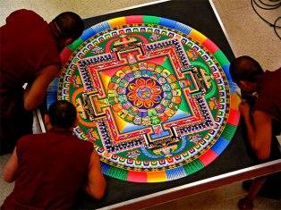 Buddhist Monks at work on the Mandala (no sneezing allowed!)
