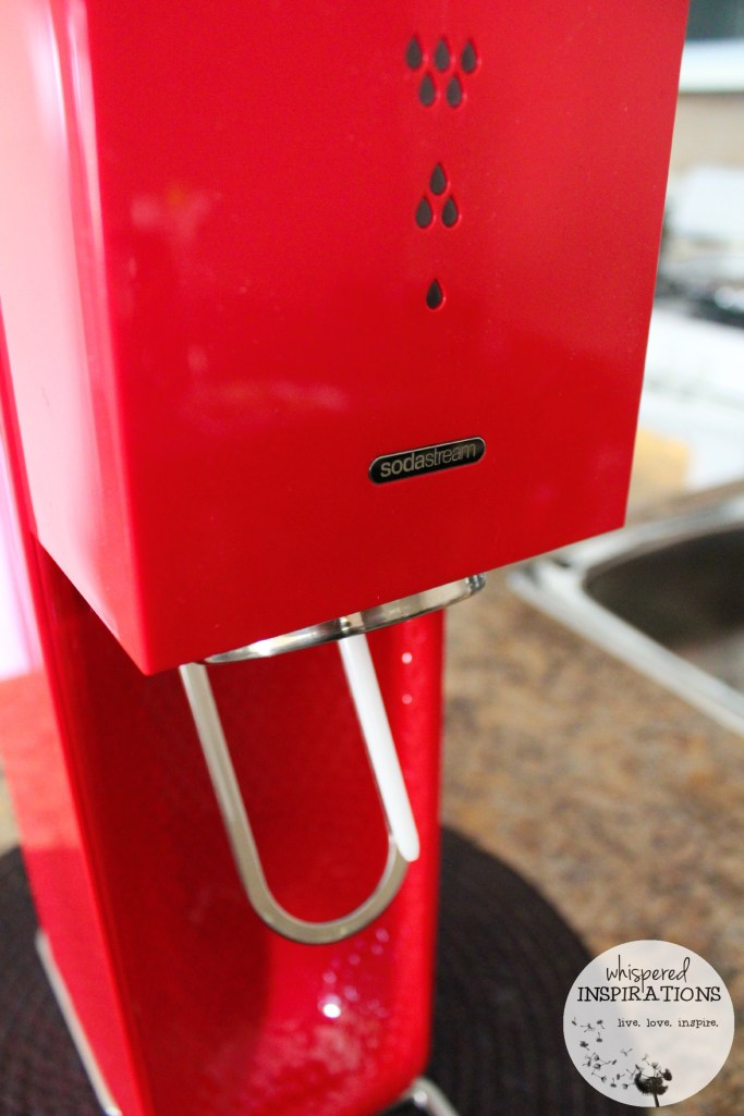 Another shot of a red SodaStream machine.
