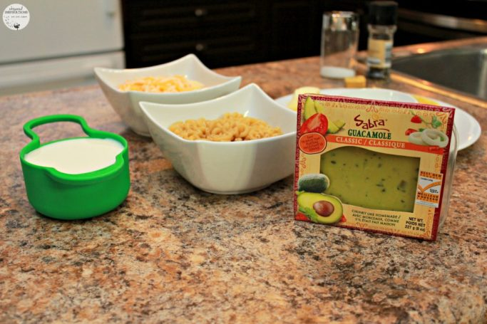 The ingredients for making macaroni and cheese are shown.