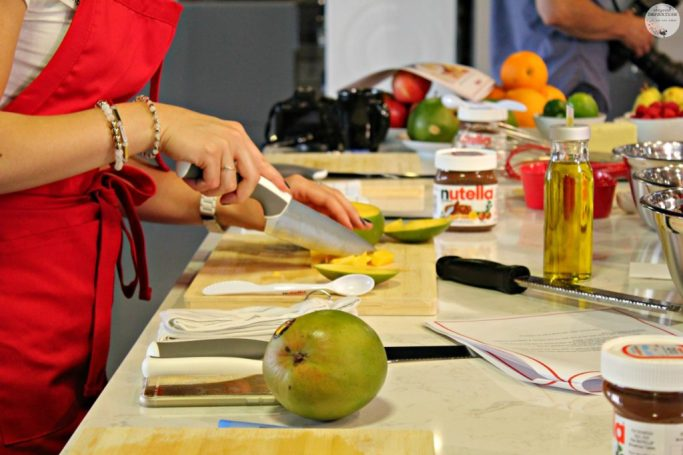 Cutting mango and working in the Nutella kitchen making recipes.