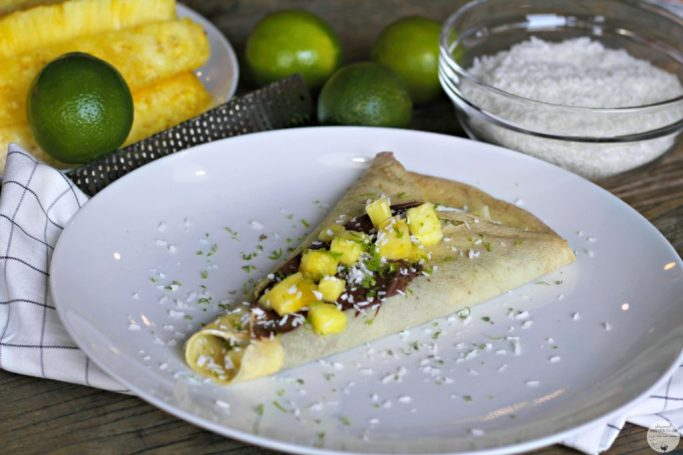 Crepe filled with Nutella, topped with pineapple, lime zest, and shaved coconut..