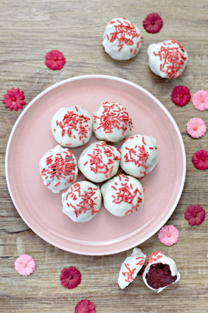 Valentine's Day Red Velvet truffles on a pink plate.