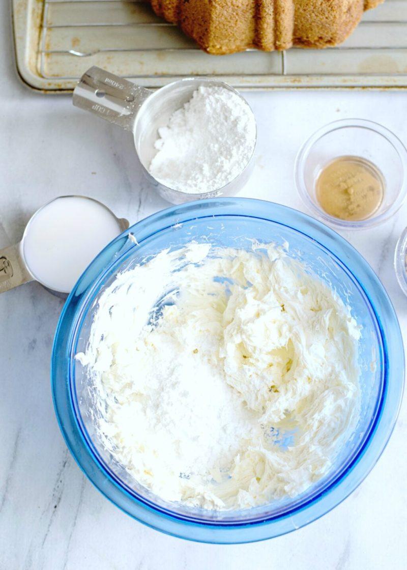 Glaze being prepared in a blue bowl.