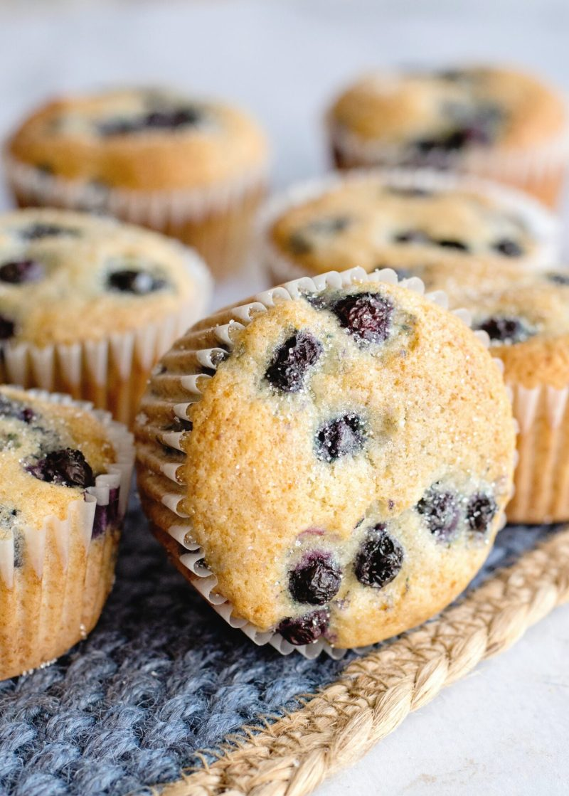 Blueberry Pancake Muffins up close, one is laying on its side.