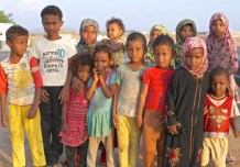 A group of black skinned children are luring on the streets of Haradth, Yemen, 2014