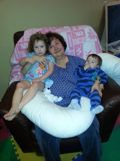 Abuela snuggling with Miss Elaina and Markie-Moose. What a happy grandma!