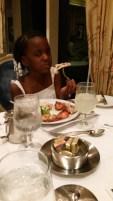 Adventure girl eating lobster