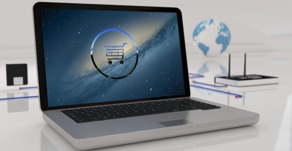 Computer with a shopping cart symbolizing ecommerce