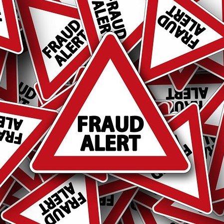 Fraud Alert Road Sign