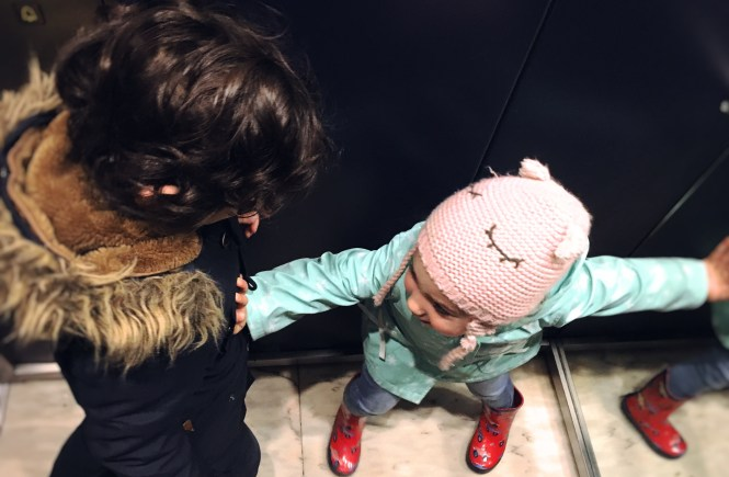 Siblings having argument on the lift