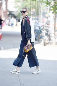 jumpsuit sneakers and bomber jacket Olivia Palermo