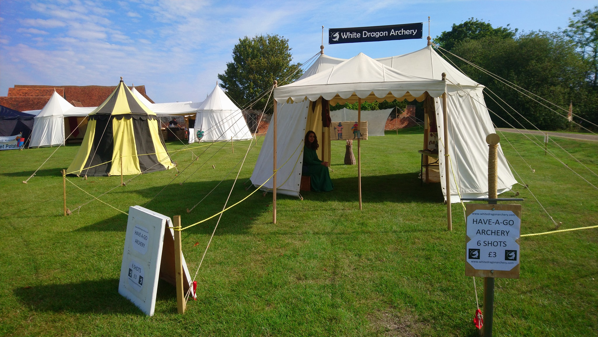 Medieval tent and have-a-go archery range at a reenactment event