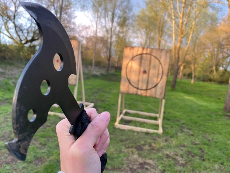 Axe being thrown at target