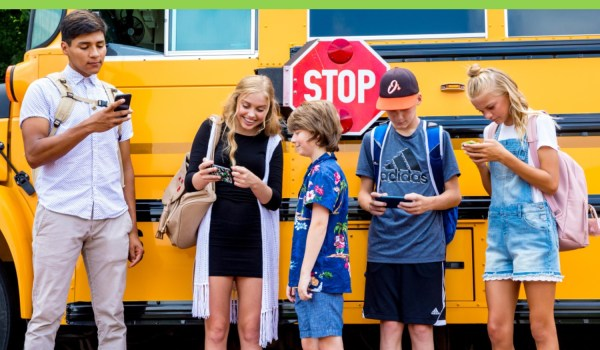 children by bus checking out phones for back to school specials